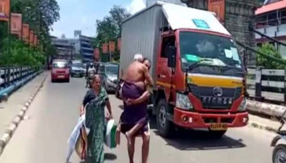 The father was denied permission to go in an auto and his father had to travel one km. The son carrying the shoulder
